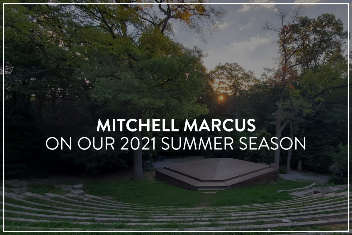 """An image of long winding stone step/seats curved in a forest clearing, centering a large wooden square stage, surrounded by trees. There's small fluffy clouds and a sunset. White text overlaid reads, """"MITCHELL MARCUS on our 2021 Summer Season"""""""